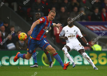 Modou Barrow of Swansea and Brede Hangeland of Crystal Palace   during the Barclays Premier League match between Crystal Palace and Swansea  played at Selhurst Park on 28th December 2015 in London