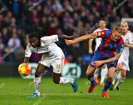 Bafetimbi Gomis of Swansea and Brede Hangeland of Crystal Palace   during the Barclays Premier League match between Crystal Palace and Swansea  played at Selhurst Park on 28th December 2015 in London