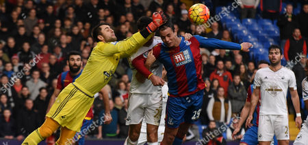 Lukasz Fabianski punches clear under pressure from Marouane Chamakh during the Barclays Premier League match between Crystal Palace and Swansea City at Selhurst Park, London