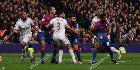 Marouane Chamakh, Wilfred Zaha and Mile Jedinak charge for the attack during the Barclays Premier League match between Crystal Palace and Swansea City at Selhurst Park, London
