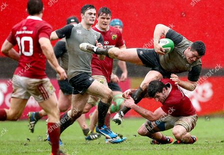 Munster's Sean O'Connor and Kelvin Brown of Ireland
