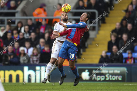 Marouane Chamakh of Crystal Palace and Ashley Williams of Swansea City both challenge for the ball