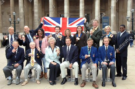 Stock Image of (L-R) Front row Bertie Thomas Bushnell, Terence Spinks, Anita Lonsbrough, Lynn Davies, Rodney Paterson, Richard Meade, (L-R) Top Row Reginald White, Duncan Goodhew, Theresa Sanderson. Sean Kerly, Sally Gunnell, Sarah Bailey, Matthew Pinset, Shirley Robertson, Harry Aryeetey