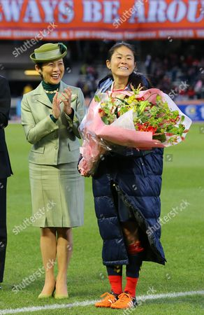 Homare Sawa of INAC Kobe Leonessa receives a bouquet of flowers from Princess Hisako Takamado