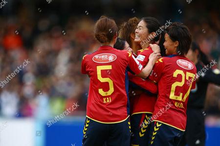Homare Sawa of INAC Kobe Leonessa celebrates with her teammates Junko Kai and Rika Masuya