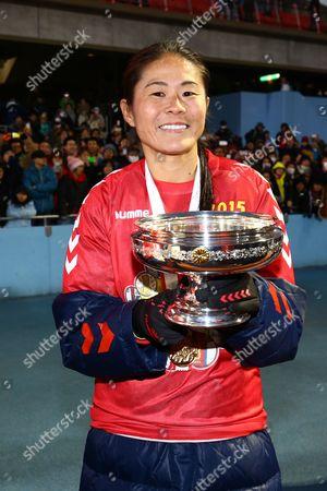 Homare Sawa of INAC Kobe Leonessa celebrates with the trophy