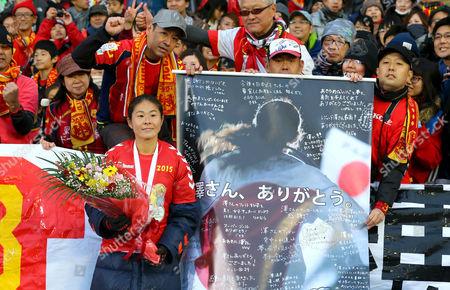 Homare Sawa of INAC Kobe Leonessa poses with fans