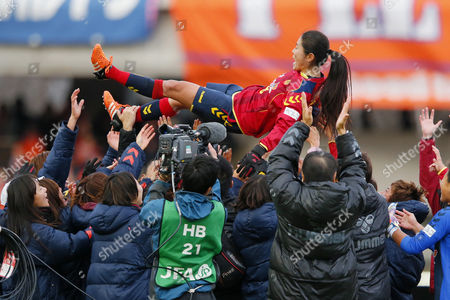 Homare Sawa of Leonessa tossed up in the air by her teammates