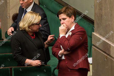 Minister Beata Kempa talks with Polish Prime Minister Beata Szydlo during an all-night session