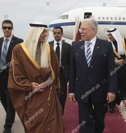 Saudi Minister of Foreign Affairs, Adel al-Jubeir (R) walks with his Tunisian conterpart Taieb Baccouche at his arrival in Presidential Carthage Airport in Tunis