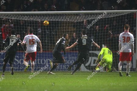 Jay Simpson of Leyton Orient (C) scores the first goal for his team from the penalty spot and celebrates