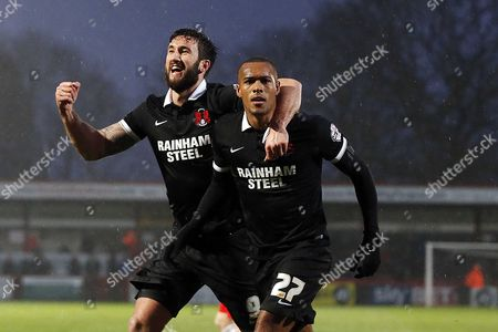 Orient's Jay Simpson celebrates after scoring from the penalty spot to make it 1-0 with Ollie Palmer