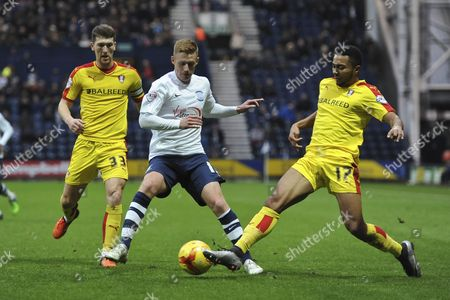 Grant Ward of Rotherham United makes a challenge on Eoin Doyle of Preston North End during Preston North End vs Rotherham United at Deepdale