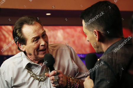 Former BDO player Bobby George and BBC presenter Collin Murray talk ahead of the first game of the day in the BDO World Darts Championships played at Lakeside Country Club, Frimley Green on 3rd January 2016
