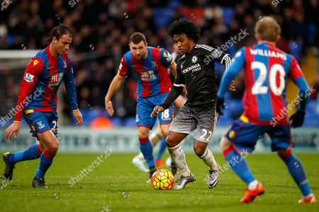 Willian of Chelsea takes on James McArthur , Jonathan Williams and Marouane Chamakh of Crystal Palace during the Barclays Premier League match between Crystal Palace v Chelsea played at Selhurst Park, London on January 3rd 2016