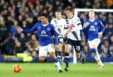 Everton's Aaron Lennon is chased by Tottenham's Tom Carroll