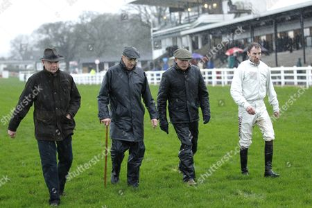 Plumpton Clerk of the Course Mark Cornford [2nd left] walks the course with trainer Chris Gordon [left] and jockey Wayne Hutchinson [right] before abandoning racing after the 3rd race.