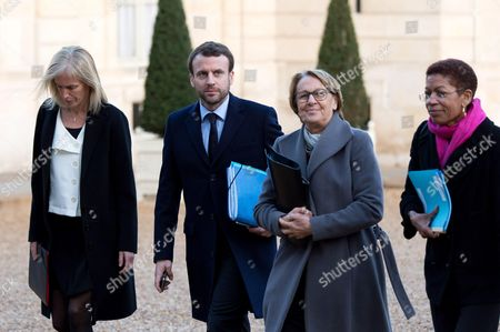 Segolene Neuville, French Economy and Industry minister Emmanuel Macron, Marylise Lebranchu, George Pau-Langevin and members of the French government arrive at the Elysee Palace for the weekly cabinet meeting