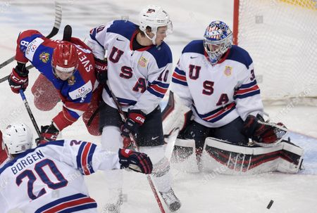 Andrei Svetlakov of Russia (2nd left) in action against Will Borgen (front left), Anders Bjork and goalkeeper Alex Nedeljkovic of USA during the 2016 IIHF World Junior Ice Hockey Championship semifinal match between Russia and USA in Helsinki