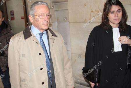 Guy Wildenstein leaves a Paris courtroom