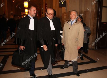 Guy Wildenstein leaves a Paris courtroom with his lawyer Herve Temime