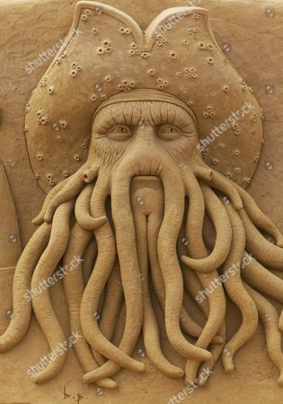 Stock Photo of Fantasy character Davy Jones, sand sculpture, tentacle beard, from the film Pirates of the Caribbean, Sand Sculpture Festival Frozen Summer Sun, Oostende, West Flanders, Belgium