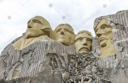 Rock portraits of four American presidents on Mount Rushmore, replica made of Lego bricks, Legoland Billund, Denmark