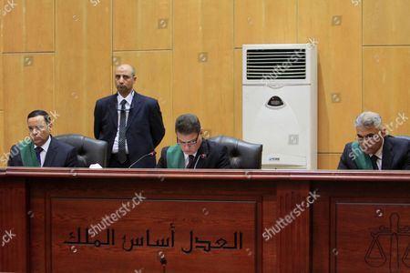 An Egyptian Judge attends the trial of ousted Egyptian president Mohamed Morsi, during the 'Qatar espionage' case, in a court in Cairo