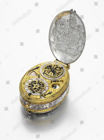 Stock Photo of David Ramsay: A circa 1618 early silver and gilt-metal oval astronomical verge watch with portrait engraving of King James I sold for £989,000