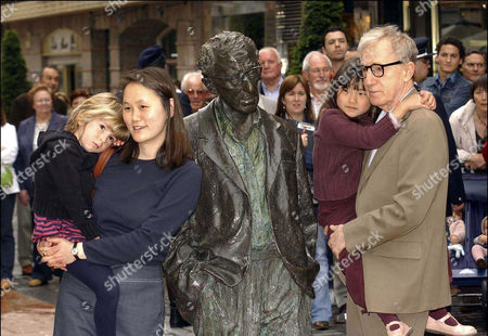 Woody Allen with his statue and wife, Soon - Yi and their two adopted daughters Bechet Dumaine and Manzie Tio