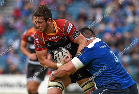 James Benjamin, Newport Gwent Dragons, is tackled by Marty Moore, Leinster