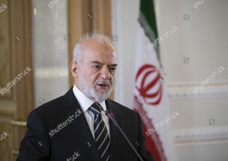 Iraqi Foreign Minister Ibrahim al-Jaafari speaks with media during a joint news conference with his Iranian counterpart Mohammad Javad Zarif (Not pictured) in a Foreign Ministry building