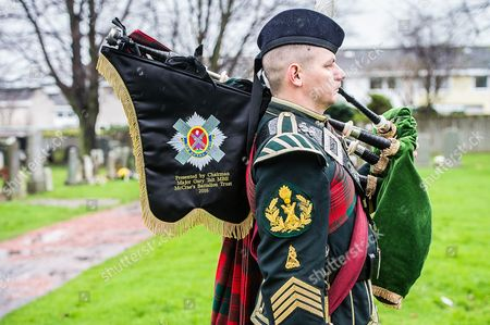 Pipe Major Stuart Gillies at a memorial for Sergeant William Duguid