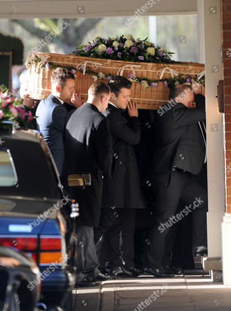 Mark Wright carrying the coffin of Nanny Pat