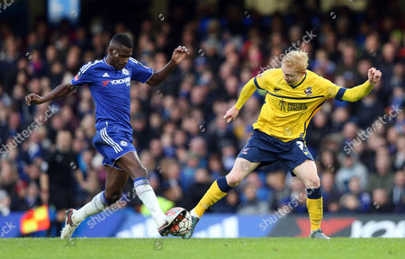 Chelsea's Ramires is challenged by Luke Williams of Scunthorpe United