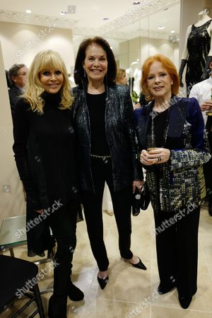 Stock Image of Britt Ekland, guest and Luciana Paluzzi