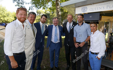 (L to R) England Cricketers Johnny Bairstow Johann Rupert Trainers John Ferguson and Ed Dunlop with Jimmy Anderson and James Taylor enjoying the racing at The L'Ormarins Queen's Plate after the second Test Kenilworth Cape Town