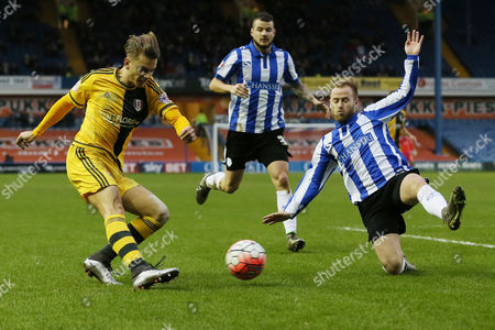 Alex Kacaniklic of Fulham and Sheffield Wednesday's Barry Bannan during the FA Cup 3rd round match between Sheffield Wednesday v Fulham played at the Hillsborough Stadium on January 9th 2016