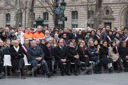 Laurent Fabius, Gerard Larcher, Anne Hidalgo, Francois Hollande, Manuel Valls, Sandrine Mazetier, Bertrand Delanoe, Najat Vallaud-Belkacem, Marisol Touraine and Johnny Hallyday attend a commemorative ceremony held for the victims of Charlie Hebdo shootings, in Paris's Place de la Republique