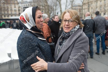 Latifa Ibn Ziaten and Marylise Lebranchu attend a commemorative ceremony held for the victims of Charlie Hebdo shootings, in Paris's Place de la Republique