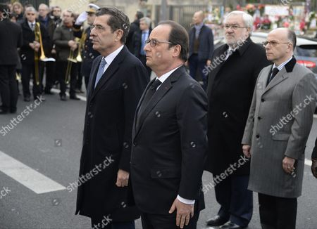 French President Francois Hollande, mayor of Montrouge Jean-Loup Metton, Secretary of State for Veterans and Remembrance Jean-Marc Todeschini and Minister of the Interior Bernard Cazeneuve during a tribute honoring policewoman Clarissa Jean-Philippe who died in last year's January attacks