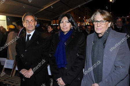 Former President Nicolas Sarkozy, Paris Mayor Anne Hidalgo and Marylise Lebranchu being pictured during the Paris One Year Remembrance's Ceremony of the Hyper Cacher's attack