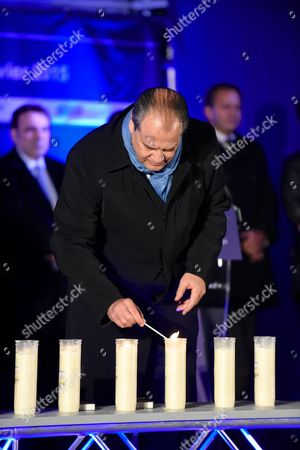 Jean-Christophe Cambadelis being pictured during the Paris One Year Remembrance's Ceremony of the Hyper Cacher's attack while lighting a candle in the memory of the 4 Victims (Yohav Hattab, Yohan Cohen, Philippe Braham et Francois-Michel Saada)