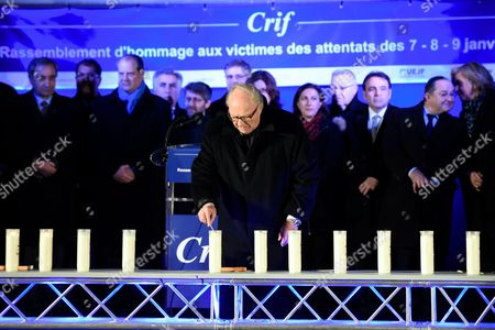 President of the CRIF Roger Cukierman being pictured during the Paris One Year Remembrance's Ceremony of the Hyper Cacher's attack while lighting a candle in the memory of the 4 Victims (Yohav Hattab, Yohan Cohen, Philippe Braham and Francois-Michel Saada)