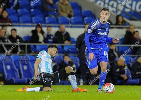 Federico Macheda of Cardiff City passes Nat Knight-Percival of Shrewsbury Town