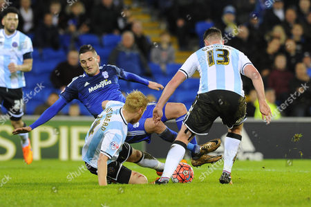 Federico Macheda of Cardiff City is tackled by Zak Whitbread of Shrewsbury Town