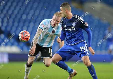 Federico Macheda of Cardiff City wins the ball from Zak Whitbread of Shrewsbury Town
