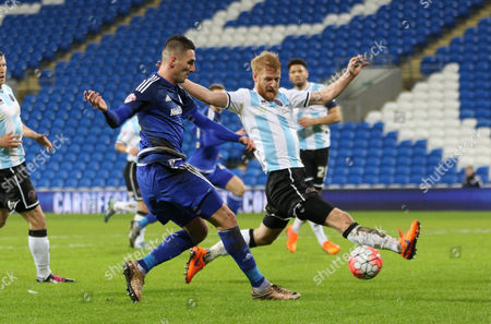 Federico Macheda of Cardiff City tries to get a shot at goal as Zak Whitbread of Shrewsbury Town closes in