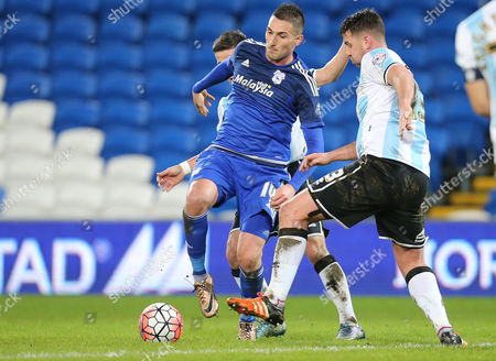 Federico Macheda of Cardiff City is challenged by Ian Black of Shrewsbury Town and Anthony Gerrard of Shrewsbury Town