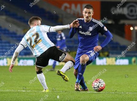 Federico Macheda of Cardiff City gets past Jordan Clark of Shrewsbury Town